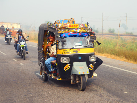 auto rickshaw: AGRA, INDIA - NOVEMBER 16, 2012  Auto rickshaw on indian road