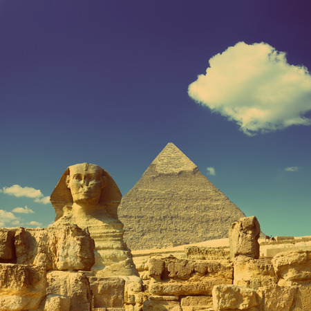 cairo: famous ancient egypt Cheops pyramid and sphinx in Giza - vintage retro style