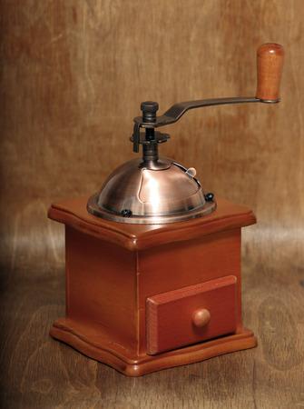 vintage coffee grinder on old wooden background photo