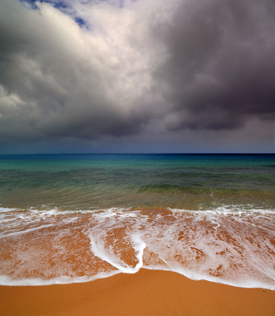 dramatic sea landscape with moody sky photo
