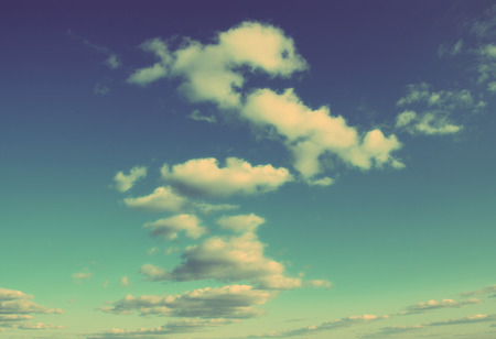 scenic blue sky with few clouds background - vintage retro style Stock Photo