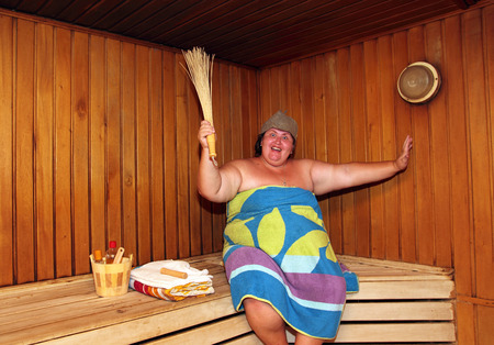 fun big overweight woman in sauna