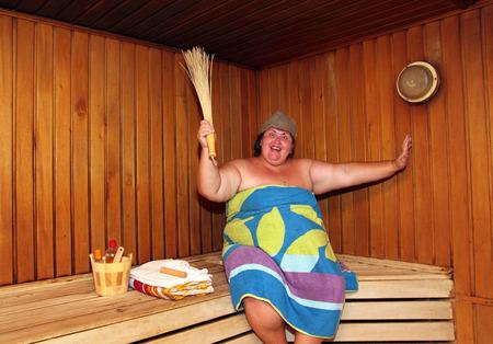 washhouse: fun big overweight woman in sauna