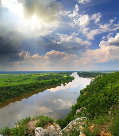 landscape with river and rain on horizon - view from rock  photo