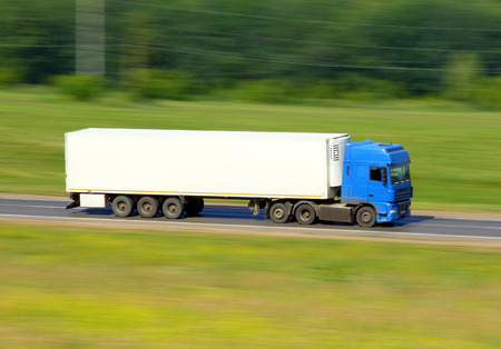 delivery truck: truck driving on a road - slow shutter  Stock Photo