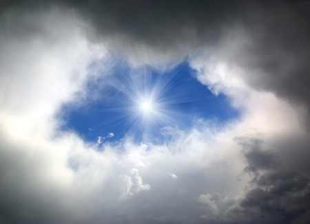 hole of blue sky in the dark clouds photo