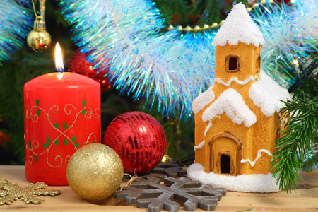 Christmas decoration - candle, house, snowflakes and balls photo