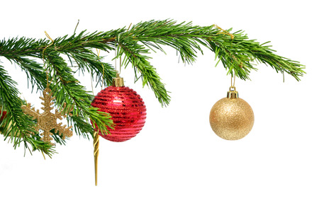 christmas holiday toys on fir tree twig over white background photo