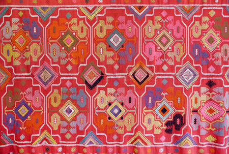 tapestry: the fabric embroidered with oriental ornaments - background Stock Photo