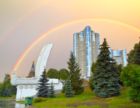 shallop: Monument Boat or Shallop on the waterfront of Samara city in Russia against rainbow