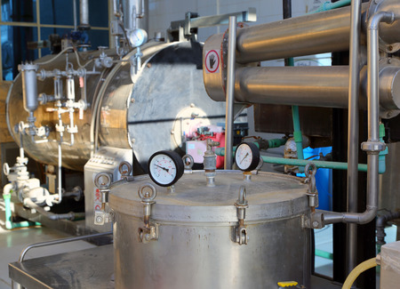 distillation of essential oils in a factory Stock Photo
