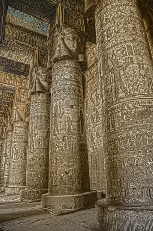 Interior of the painted and carved hypostyle hall at Dendera Temple. Ancient Egyptian temple near Qena. HDR image.