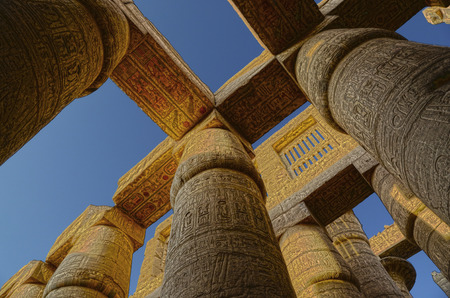 ancient egyptian civilization: columns in karnak temple with ancient egypt hieroglyphics - HDR image