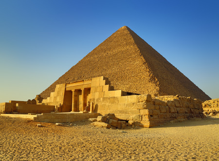 ancient egyptian civilization: The entrance of the mastaba of Seshemnufer IV and the Great Pyramid in background. Giza, Cairo, Egypt Stock Photo