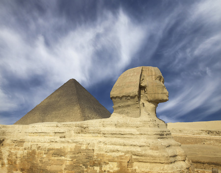 cheops: Famous ancient egypt Cheops pyramid and sphinx in Giza Cairo Stock Photo