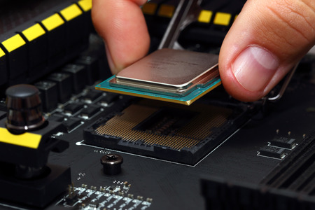 Installing modern central processor unit into motherboard photo