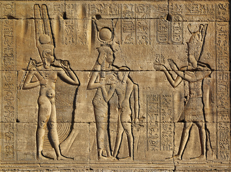 Hieroglyphic carvings on the exterior walls of an ancient egyptian temple Reklamní fotografie