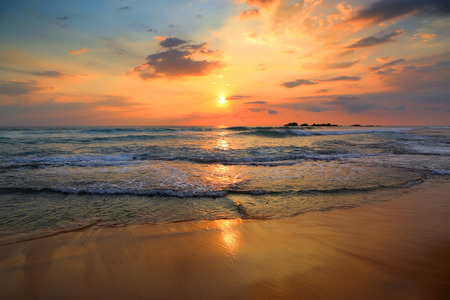 tropical sunset: beautiful landscape with tropical sea sunset on the beach