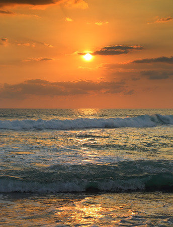 beautiful landscape with tropical sea sunset and waves photo