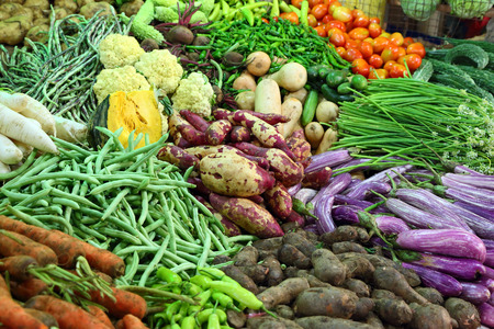 heap of various vegetables on market in asia photo