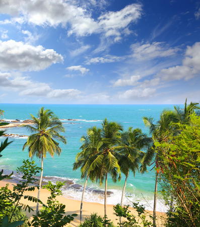 beautiful tropical beach landscape with turquoise sea and clouds photo