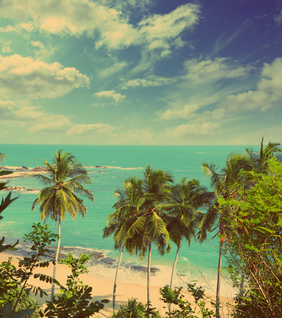 beautiful tropical beach landscape with turquoise sea and clouds - vintage retro style photo