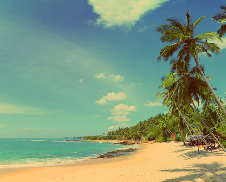 beautiful tropical beach landscape with clouds - vintage retro style photo