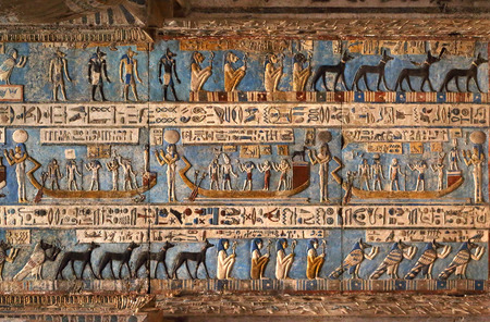religious symbols: Hieroglyphic carvings and paintings on the interior walls of an ancient egyptian temple in Dendera