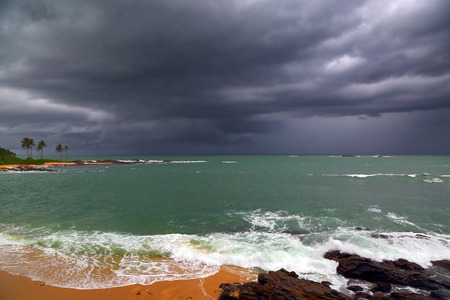 Beautiful sea stormy landscape over rocky coastline in Indian ocean photo