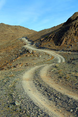 winding up: winding mountain road leading up