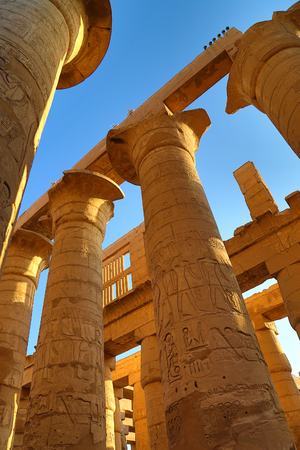 hieroglyphics: Columns in Karnak temple with ancient egypt hieroglyphics, Luxor Stock Photo