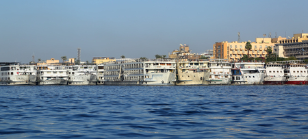 embark: old passenger ships standing in Luxor port on Nile river