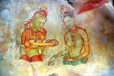 sigiriya: SIGIRIYA, SRI LANKA - MARCH 20, 2015: Sigiriya maiden - 5th century frescoes at the ancient rock fortress of Sigiriya in Sri Lanka