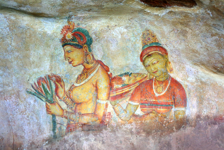century: SIGIRIYA, SRI LANKA - MARCH 20, 2015: Sigiriya maiden - 5th century frescoes at the ancient rock fortress of Sigiriya in Sri Lanka
