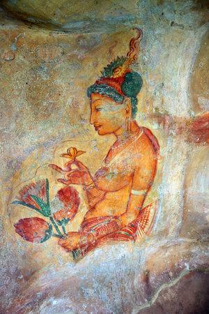 lions rock: SIGIRIYA, SRI LANKA - MARCH 20, 2015: Sigiriya maiden - 5th century frescoes at the ancient rock fortress of Sigiriya in Sri Lanka