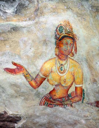 lanka: SIGIRIYA, SRI LANKA - MARCH 20, 2015: Sigiriya maiden - 5th century frescoes at the ancient rock fortress of Sigiriya in Sri Lanka