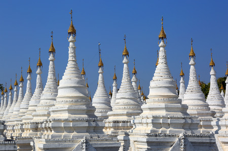 scriptures: Large stupa forest of the Sandamuni Paya pagoda in Mandalay, Myanmar (Burma) Stock Photo