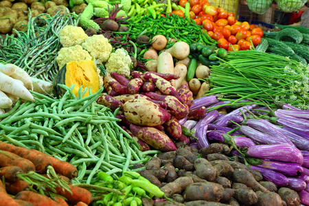 weigher: heap of various vegetables on market in asia Stock Photo