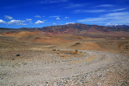 Landscape with rocky dirt road in the Altai Mountains, Russia