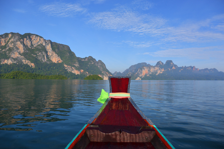 View from moving long tail boat on Cheow Lan lake at Khao Sok National Park in Thailand