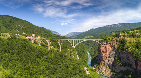 Djurdjevica Tara Bridge is a concrete arch bridge over the Tara River in northern Montenegro. 365m long and the roadway stands 172 metres above the river. Aerial panorama.