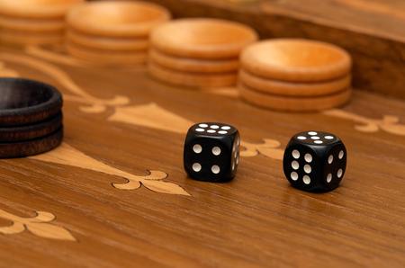 Dice on a backgammon board close-up macro Stock Photo