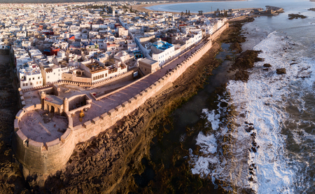 Aerial panorama of medieval Essaouira old city on Atlantic coast at sunset, Morocco Stock Photo