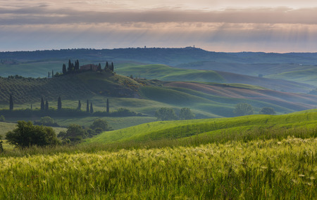 Tuscany landscape at sunrise with farm house and hills, Italy