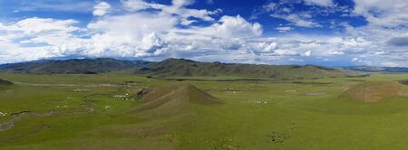 Aerial panorama view of yurts in steppe and mountains landscape in Orkhon valley, Mongolia Stock Photo