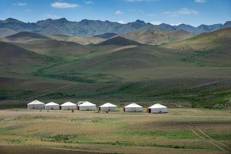 Yurts between montains in Mongolia Foto de archivo - 132124324