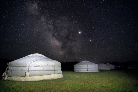 Milky way in the sky at night in Mongol desert at a ger tent camp