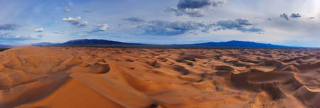 Aerial panorama view of the sand dunes Hongoryn Els in Gobi Desert at sunset, Mongolia