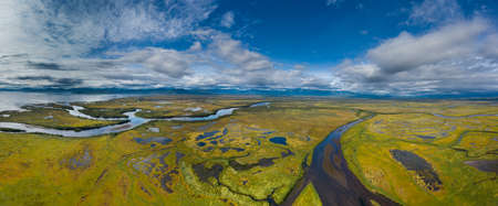 Aerial panorama view of Avacha river delta and hilly landscape, Kamchatka Peninsula, Russia