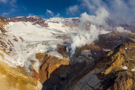 Aerial view of crater with fumaroles of active Mutnovsky volcano, Kamchatka, Russia